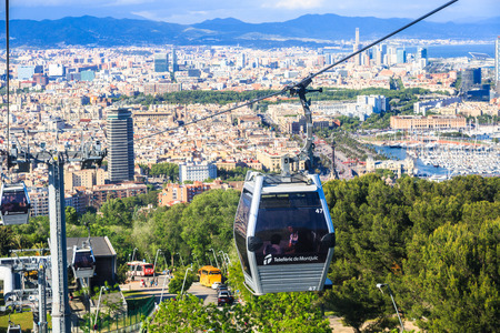 montjuic: Barcelona, Spain - May 29, 2016: Montjuic funicular, panaramic view of Barcelona, Barceloneta area and seaport Vell de Barcelona on the background