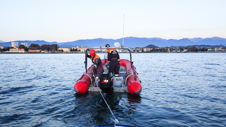 curfew: Sochi, Russia - NOVEMBER 8, 2014: work of Russian Emergency Situationsa Ministry, Rescue Marine Service towing a broken boat from the sea. Curfew in border area