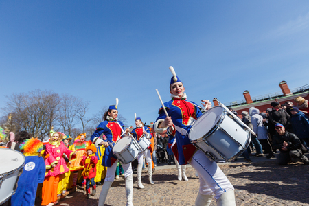 harlequin clown in disguise: Show of drummers on Funny festival VIX in Saint-Petersburg