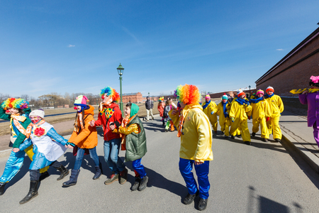 troupe: Saint-Petersburg, Russia - April 1, 2017: Procession of clowns on Funny festival XVI on Peter and Paul Fortress territory