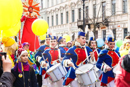 harlequin clown in disguise: Saint-Petersburg, Russia - April 1, 2017: Show of drummers on Funny festival XVI Editorial