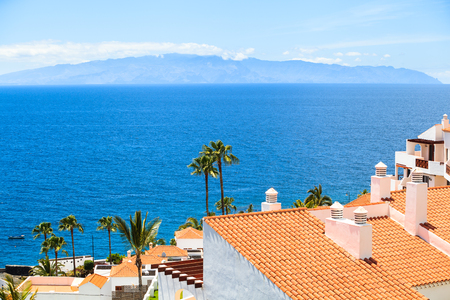 residential apartments of Los Gigantes, Tenerife, Spain. La Gomera island on the background 스톡 콘텐츠
