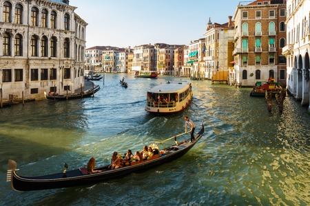 View from Ponte di Rialto to Venice, Grand canal, gondolas and big pleasure boat