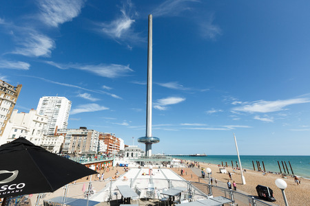 People admire walking on Brighton costline, view of English channel, tower i360 Redakční