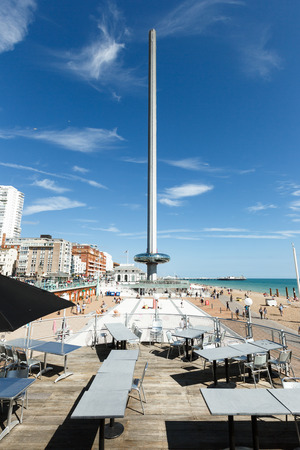 People admire walking on Brighton costline, view of English channel, tower i360 Editorial
