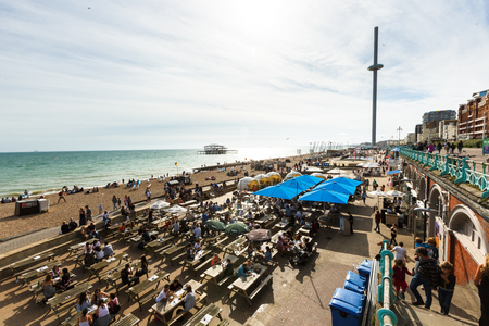 People have rest in Brighton costline restaurants, English channel, tower i360 Redakční