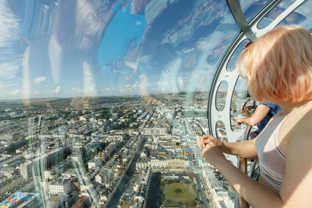 visitors enjoy the view of Brighton coastline from a birds-eye view