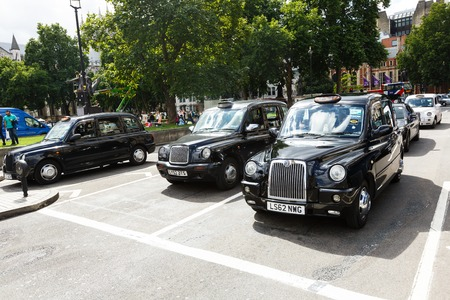 Legendary London taxi cab on the streets of London Editorial