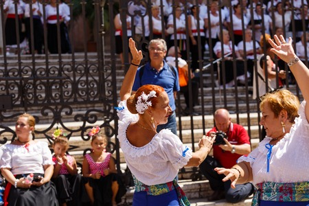 Women dance flamenko near Malaga Cathedral on city holiday of Holy Virgin Mary