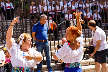 Women dance flamenko ans sing near Malaga Cathedral on city holiday of Holy Virgin Mary