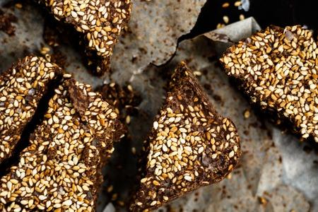 Closeup luxury handmade dark chocolate with seasame and sea salt, in paper