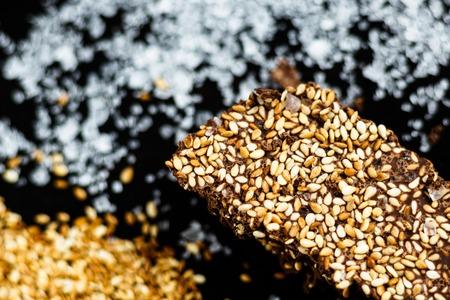 Luxury handmade dark chocolate with seasame and sea salt, black background 写真素材 - 121182700