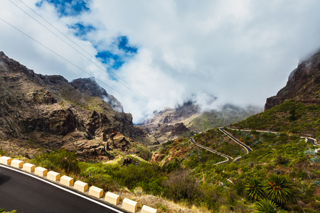 Serpentine road into fabulous Masca village in mountain gorge the most visited tourist attraction of Tenerife, Spain. 写真素材 - 121182721