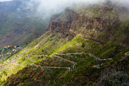 Serpentine road into fabulous Masca village in mountain gorge the most visited tourist attraction of Tenerife, Spain.
