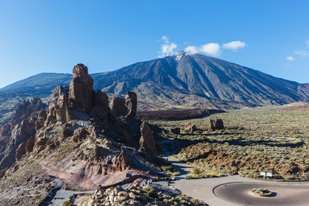 Highway in national park, unique emblematic Teide Volcano of Tenerife island 写真素材 - 121182752