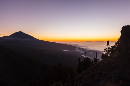 Incredible sunset landscape in the mountains. Clouds lie on the mountainside 写真素材 - 121182760