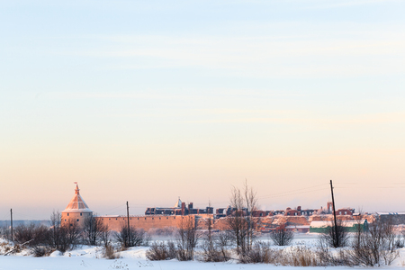 Winter evening view of Oreshek fortress in Shlisselburg, clean sky background