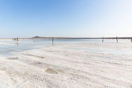 Baskunchak lake, Russia - August 28, 2018: view of salt lake in Akhtubinsky district of Astrakhan region. People are swimming in healing salt water 写真素材