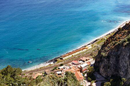 Aerial breathtaking view of Giardini Naxos railway station, shore of Ionian sea