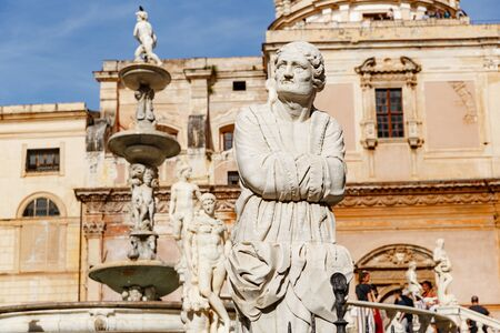 Palermo, Italy - May 9, 2019: magnificent front view of Praetorian fountain with monuments in Piazza Pretoria (Praetorian Square), bright sunny day, Santa Catarina church on the background Editorial