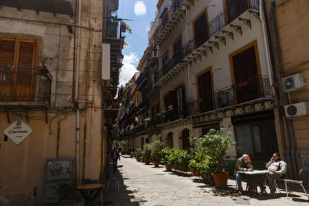 Palermo, Sicily, Italy- May, 05, 2019: Palermo's slow measured life. A cozy street, cyclists, pedestrians,