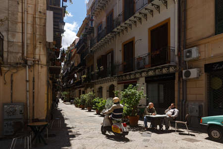 Palermo, Sicily, Italy- May, 05, 2019: Palermo's slow measured life. A cozy street cyclists pedestrians Éditoriale