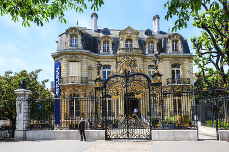 PARIS, FRANCE - May 18, 2015: Paris Marcel Dassault Hotel at Champs-Elysees. Marcel Dassault Hotel was built in 1844. Marcel Dassault Hotel which houses Artcurial is today a space dedicated to art. 報道画像