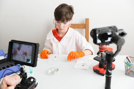 9 year old boy makes educational video about chemical experiments for his vlog