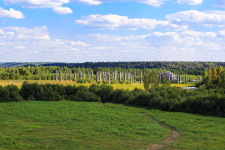 Nikola-Lenivec, Russia - August 23, 2015: Panorama of Wooden and steel sculptures in the Art Park Nikola Lenivets National park, Kaluga Region, Art-objects The Universal Mind