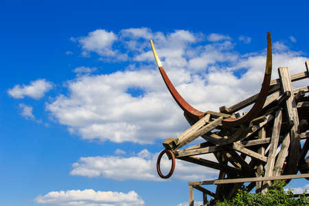 Nikola-Lenivec, Russia - August 23, 2015: Wooden and steel sculpture in the Art Park Archstoyanie, Nikola Lenivets National park, Kaluga Region, Art-objects The Gold Plated Bull