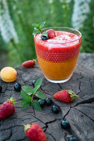 Blended Colorful Strawberry Apricot Sugar Free Smoothie with Chia Seeds and Mint 写真素材