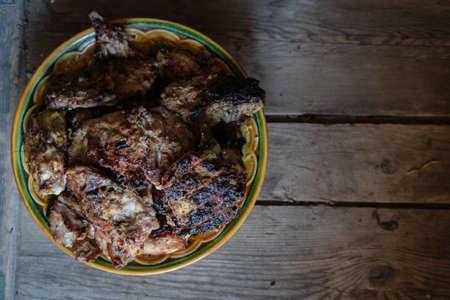 Turkey fillet in batter in a ceramic bowl on the wooden table, low key Banco de Imagens