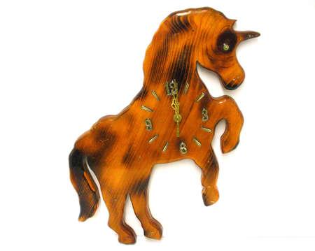 made: Unicorn clock made of wood. Stock Photo