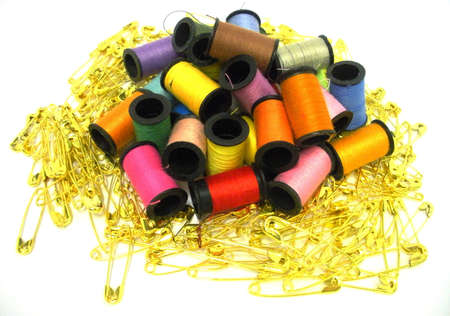 Bobbins with thread and safety pins for sewing photo