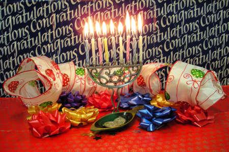 Hanukkah congratulations with Menora and candles