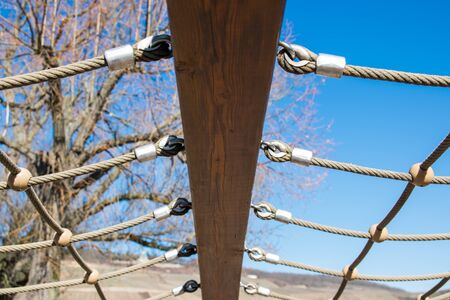 Blue sky with trees and beam with iron binding for exercise and sport.