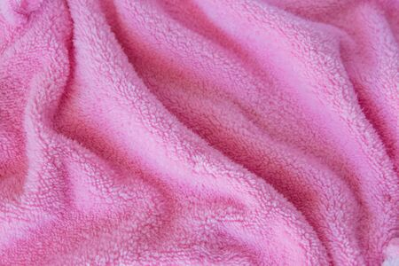 Texture fabric. Textile pink knitted cloth background.