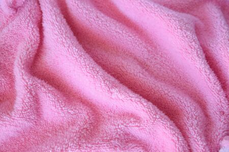 Bright texture fabric. Textile pink knitted cloth background. Reklamní fotografie