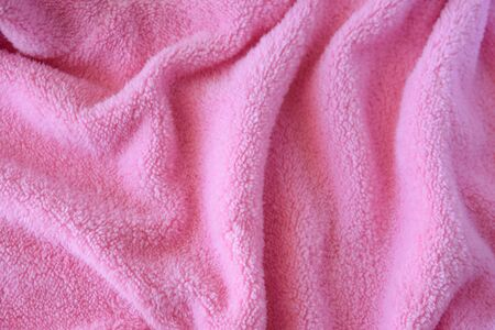 Knitted pink texture fabric. Textile cloth background.