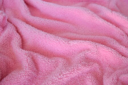 Texture fabric of pink color. Textile cloth background.