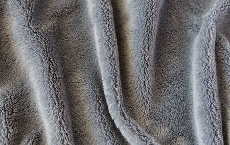 Texture fabric. Textile warm grey knitted cloth background. Reklamní fotografie