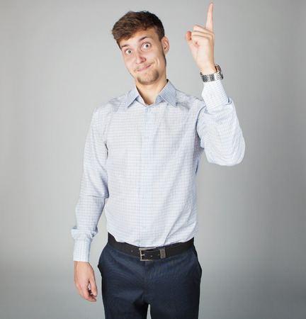 exiting: Young business man in white shirt comes up with an exiting idea expressing positive emotions on his face.