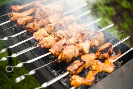 Shish kebab roasting on the grill. BBQ party.