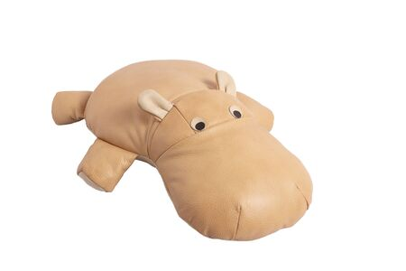 Beige toy leather hippo lies on a white background