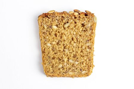 Slice of multigrain bread with sunflower and pumpkin seeds and flax seed on a white background. Diet, healthy food, weight loss