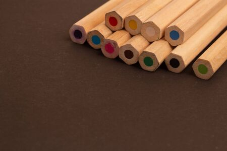 Color pencils lie diagonally with a blunt end on a black background. Beautiful colored pencils. Pencil drawing