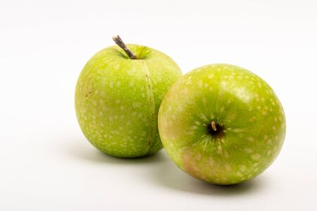 Two Green ripe apple close up on a white background. Healthy food, diet