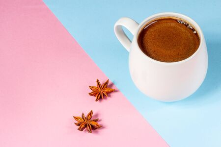 Black coffee in a white mug on a pink and blue background Stockfoto