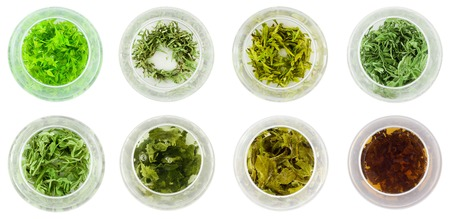 Eight bowls of various green tea