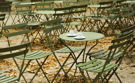Empty parisian cafe with two coffee cups   Banco de Imagens